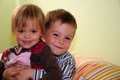 Cute siblings. Brother hugging his little sister Royalty Free Stock Images