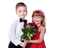 Cute siblings greet smb with bouquet isolated Royalty Free Stock Photo