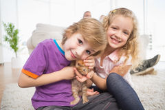 Cute siblings with kitten Stock Image