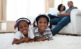 Cute siblings listening music Royalty Free Stock Photos