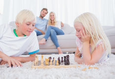 Cute siblings playing chess Royalty Free Stock Photography