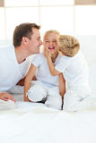 Cute siblings playing with their father Stock Images