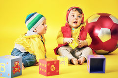 Cute siblings playing toy bricks Stock Photography