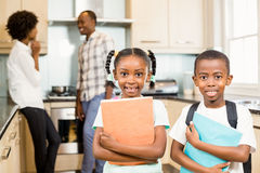 Cute siblings ready for school. Looking at the camera in the kitchen Stock Photo