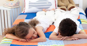 Cute Siblings sleeping Stock Photo