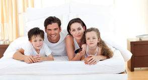Cute siblings and their parents Stock Image