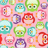 Cute Simple Cartoon Patterned Owls, Seamless Tile. Some cute patterned-belly owls in a seamless pattern that repeats Royalty Free Stock Photography