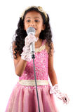 Cute Singer. A portrait of a cute Indian girl in a singing performance, on white background Royalty Free Stock Images