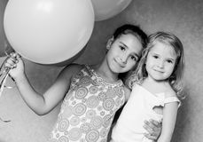 Cute sisters with  balloons. Cute sisters with balloons house  ( black and white Royalty Free Stock Image