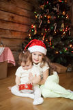 Cute sisters playing with a gift box Stock Photography