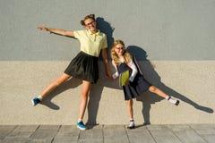 Cute sisters schoolgirl in school uniform. stock photos