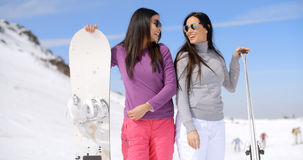 Cute sisters with snowboards Royalty Free Stock Images