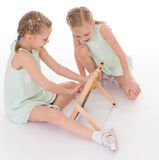 Cute sisters work in the Montessori environment. Royalty Free Stock Photography