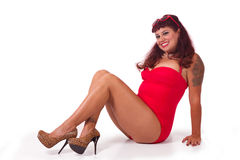 Cute sitting pinup in red swimsuit Stock Image