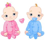Cute sitting twins Royalty Free Stock Photography