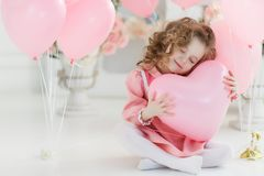 Free Cute Six Year Old Girl In Pink Dress With Pink Balloons In The Shape Of Heart Stock Photography - 108503652