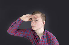 cute sixteen year old boy in studio looking into the far Royalty Free Stock Images