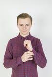 Cute sixteen year old boy in studio. Portrait of cute sixteen year old boy in studio stock photo