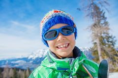 Cute skier boy in a winter ski resort. royalty free stock photo