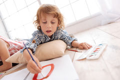 Cute skillful boy painting a picture Royalty Free Stock Image