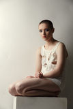 Cute skinhead girl in torn T-shirt posing as crazy Royalty Free Stock Images