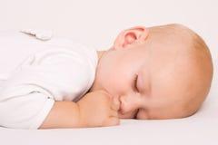 Cute Sleeping angel boy. One year old baby boy asleep with angel wings Stock Image