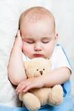 Cute sleeping baaby with teddy bear Royalty Free Stock Photo