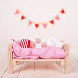 Cute sleeping baby. Cute baby boy sleeping on soft bed with valentines hearts on background Stock Images