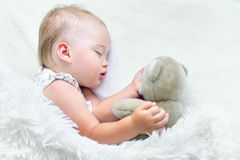 Cute Sleeping baby girl. Portrait of a cute sleeping baby girl in bed Stock Images