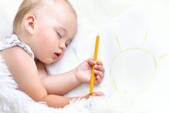 Cute Sleeping baby girl. Portrait of a cute sleeping baby girl in bed Stock Photos