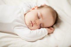 Cute sleeping baby on white background stock image