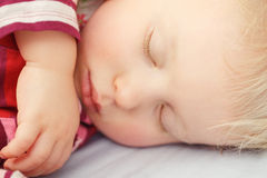 Cute sleeping blond baby Royalty Free Stock Images