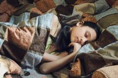 Cute sleeping girl in bed stock image