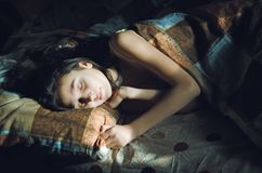 Cute sleeping girl in bed royalty free stock photo
