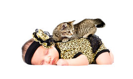 Cute sleeping newborn girl with kitten on her back. Isolated on white background Stock Photo