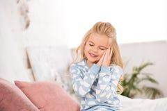 Free Cute Sleepy Child Sitting On Bed Royalty Free Stock Image - 155843356