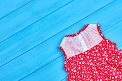 Cute sleeveless baby dress. Cotton vintage colorful baby-girl dress and copy space. Image of casual toddlers beautiful dress Stock Photo