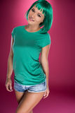 Cute slender young woman with green hair Stock Images
