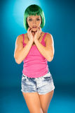 Cute slender young woman with green hair Royalty Free Stock Images