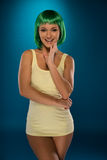 Cute slender young woman with green hair Royalty Free Stock Photos