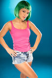 Cute slender young woman with green hair Stock Image