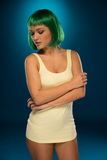 Cute slender young woman with green wig Stock Photo
