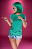 Cute slender young woman with green wig Stock Image
