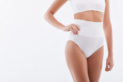 Cute slim girl is showing her body Royalty Free Stock Images