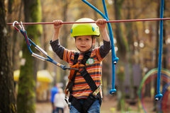 Cute small boy enjoying a sunny day in a climbing Royalty Free Stock Photography