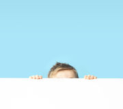Cute small boy hiding himself Royalty Free Stock Photos