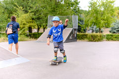 Cute small boy learning to skateboard Stock Photography