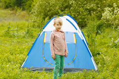 Cute small boy near a tent on nature background . Stock Photography