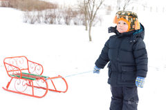 Cute small boy pulling a sled Stock Image