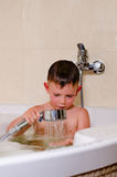 Cute small boy showering in the bath Stock Photography